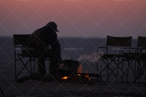 Campfire Breakfast At Sunrise In The Makgadikgadi Pan Botswana