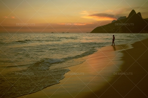 Sun Sets On Man Walking Into Rio Beach Sea