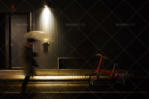 Motion Blurred Man Runs In Kyoto Rainfall Towards Red Commuter Bike