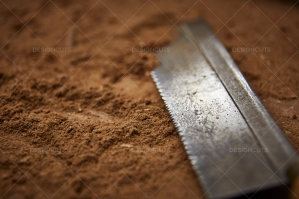 Closeup Of Blade Imbedded In Sawdust