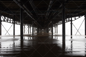 Under A Pier On A British Beach