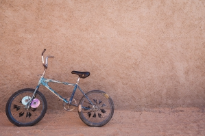 A Child's Bike Leant Up Against A Wall