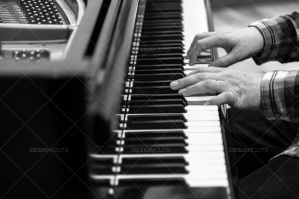 A Close Up Of A Mans Hands Playing A Grand Piano No. 4