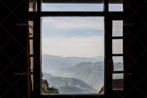 A View Through A Hotel Window In Shimla To The Foothills Of The Himalayas