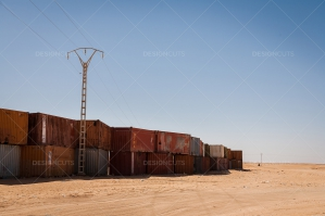 A Wall Of Shipping Containers In The Sahara Desert