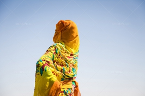A Young Sahrawi Woman Dancing Wearing A Traditional Dress