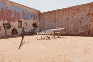 An Old Hospital Bed In The Courtyard Of A Crumbling Desert Hospital