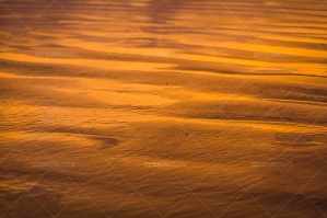 Close Up Of Sand On A UK Beach At Sunset