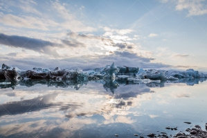 Icebergs And Clouds Reflected In The Water At Jökulsárlón Glacier Lagoon No. 1