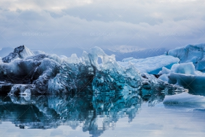 Icebergs And Clouds Reflected In The Water At Jökulsárlón Glacier Lagoon No. 3