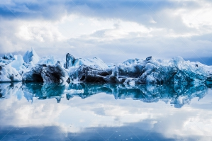 Icebergs And Clouds Reflected In The Water At Jökulsárlón Glacier Lagoon No. 4