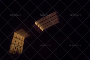 Light From A Streetlamp Projecting The Pattern Of A Window Onto The Wall And Ceiling Of A Room