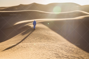 Sahrawi Nomad Walks Along A Sand Dune In The Sahara Desert No. 1