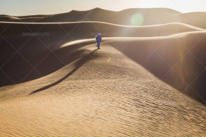 Sahrawi Nomad Walks Along A Sand Dune In The Sahara Desert No. 2