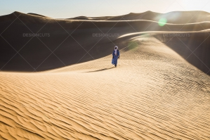 Sahrawi Nomad Walks Along A Sand Dune In The Sahara Desert No. 3