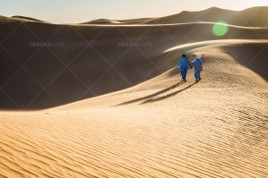 Sahrawi Nomads Walk Along A Sand Dune In The Sahara Desert No. 8