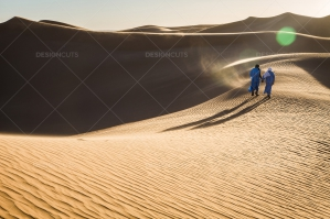 Sahrawi Nomad Walks Along A Sand Dune In The Sahara Desert 9