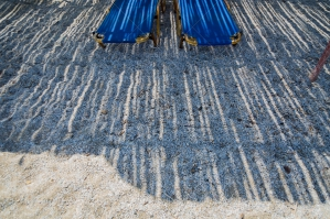 Shadows Falling On Two Sunloungers