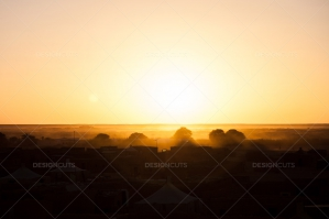 Sunset Over Traditional Tents And Trees In The Algerian Sahara Desert