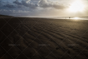Two People Walking In The Distance On The Beach At Saunton Sands, Devon