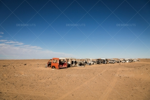 A Line Of Abandoned Cars In The Sahara Desert No. 7