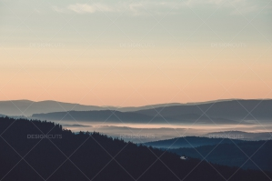 Mountain Horizon With House In Forest Above Misty Valley